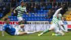 Jason Kerr challenges Ollie Burke at Celtic's penalty claim.