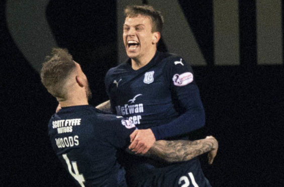 Andrew Nelson celebrates opening the scoring against Kilmarnock with team-mate Martin Woods.