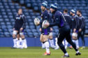 Greig Laidlaw and Stuart Hogg testing the winds at Murrayfield yesterday.