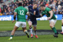 Finn Russell takes on Ireland's Bundee Aki (left) and Cian Healy.