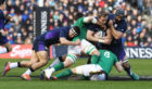Scotland's Jonny Gray is tackled by Ireland's Jack Conan.