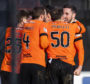 United's players celebrate Nicky Clark's winning goal at Paisley.