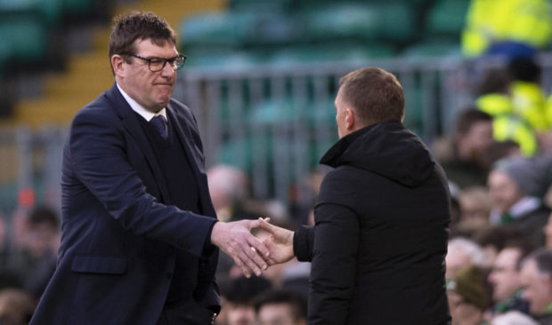 Tommy Wright skaes hands with Brendan Rodgers at full-time.