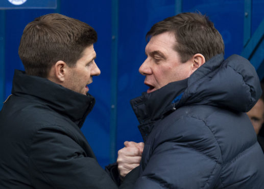 Steven Gerrard and Tommy Wright chat at full-time.