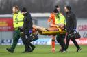 Frederic Frans gets injured at Falkirk.