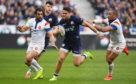 Scotland's Sean Maitland takes on France's Gael Fickou.