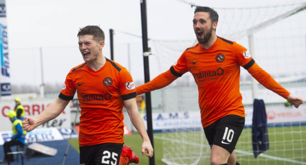 Cammy Smith, left, is joined by Nicky Clark to celebrate his goal.