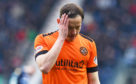 United player Peter Pawlett looks disappointed at full-time.