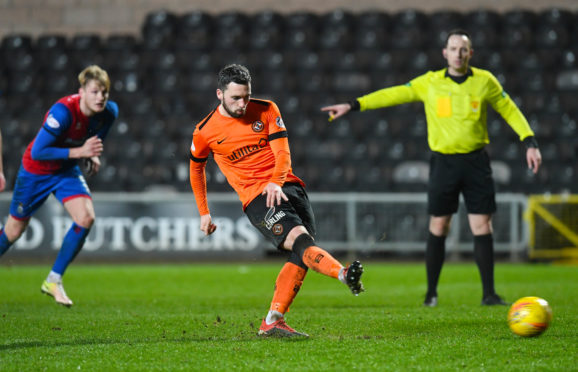 Nicky Clark scores from the penalty spot.