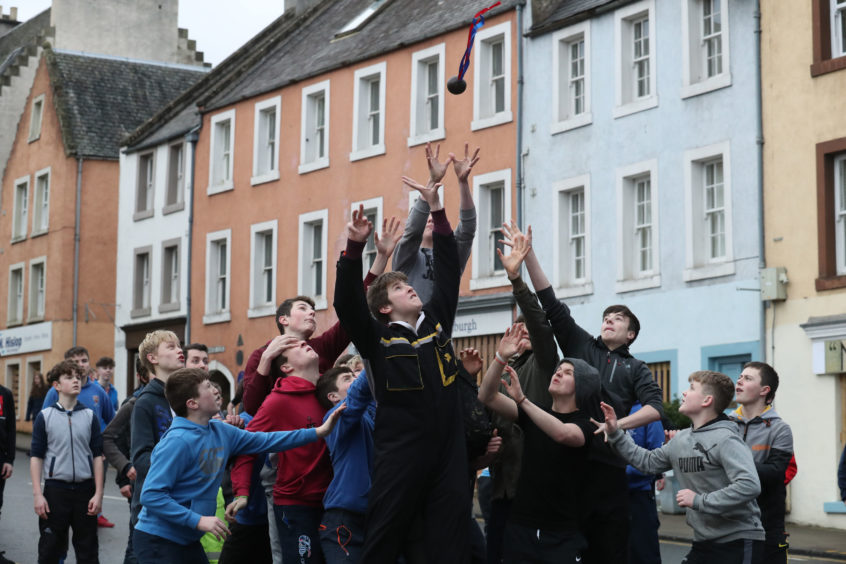 Boys jump to catch the leather ball during the annual 'FasternÕs E'en Hand Ba' event on Jedburgh's High Street in the Scottish Borders.