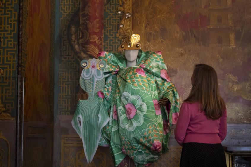 A hat designed by milliner Stephen Jones alongside a House of Dior dress.