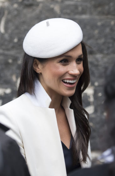 Meghan Markle leaving the Commonwealth Service at Westminster Abbey, London. The hat that she was wearing is amongst those in the Chinoiserie-on-Sea exhibition at the Royal Pavilion.