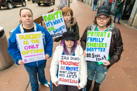 Kirstie Keatings (30), Lisha Keatings (27), Heather Bishop (32) and Damien Keatings (11) are all family and protesting about the refusal of cancer operation to former nurse Isabella Keatings.