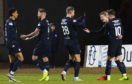 The Dundee players celebrate Andrew Nelson's (R) opener.