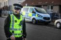 Police revisited the murder scene on Sunday