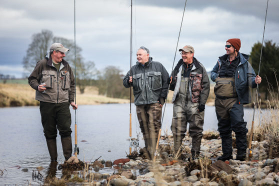 Neil Anderson, Manager of Gallery Fishings with Joe Gorman, Grant Kellie and Alan Greene bless the river with whisky to open the season. a