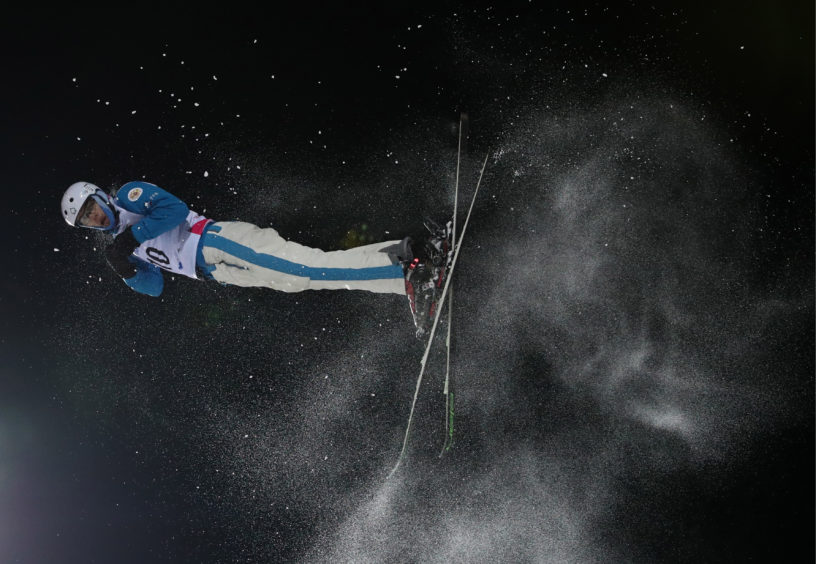 An athlete competes in the freestyle skiing aerials event at the 2019 Winter Universiade at Sopka Cluster in Russia.
