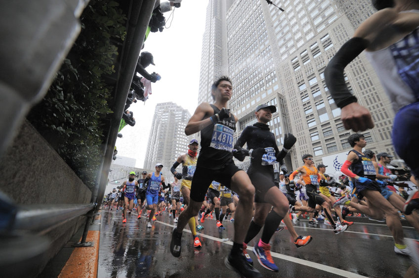 Runners are seen in front of the Tokyo Metropolitan Government as they compete during the Tokyo Marathon 2019 in Tokyo.
