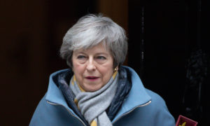 British Prime Minister Theresa May leaves following a cabinet meeting at 10 Downing Street on March 13, 2019 in London.
