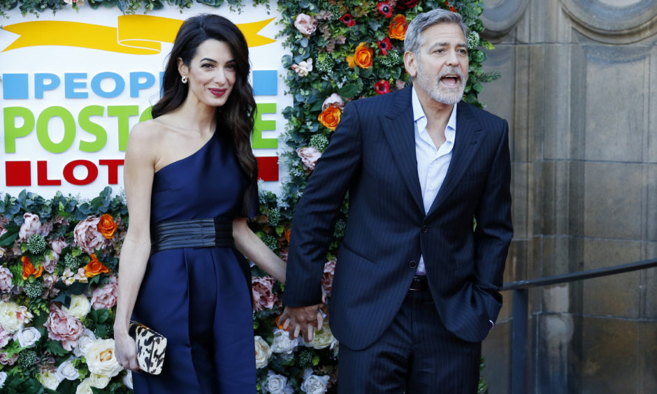 George and Amal Clooney attend the Peoples Postcode Lottery Charity Gala at McEwan Hall in Edinburgh. The couple were honoured for their international humanitarian work through the Clooney Foundation for Justice.