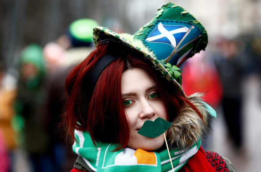 People participate in the Saint Patrick's Day celebrations at the Sokolniki Park in Mosco. Saint Patrick's Day is a cultural and religious celebration held on 17 March, the traditional death date of Saint Patrick, the foremost patron saint of Ireland. On St Patrick's Day it is customary to wear shamrocks or green clothing or accessories.