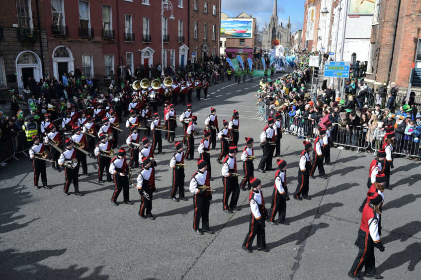 Festival participants take part in the annual Saint Patrick's Day parade on March 17, 2019 in Dublin, Ireland. Saint Patrick, the patron saint of Ireland is celebrated around the world on St. Patrick's Day. According to legend Saint Patrick used the three-leaved shamrock to explain the Holy Trinity to Irish pagans in the 5th-century after becoming a Christian missionary