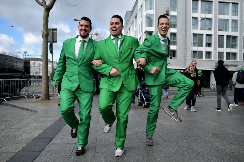 Revellers attend the Saint Patrick's Day parade on March 17, 2019 in Dublin, Ireland.