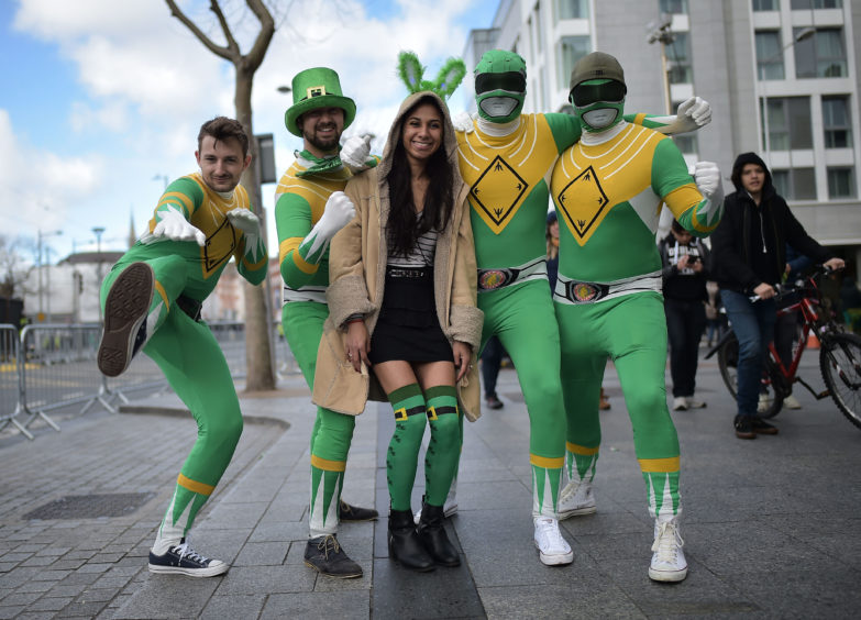 Revellers attend the Saint Patrick's Day parade on March 17, 2019 in Dublin,