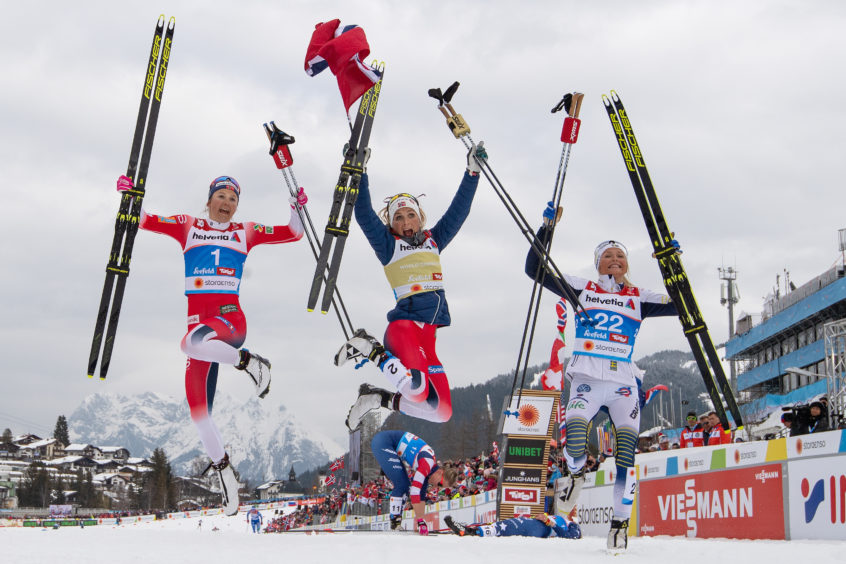 Silver medalist Ingvild Flugstad Oestberg of Norway, gold medalist Therese Johaug of Norway and bronze medalist Frida Karlsson of Sweden celebrates following the Women's Cross Country 30k race during the FIS Nordic World Ski Championships in Seefeld, Austria.