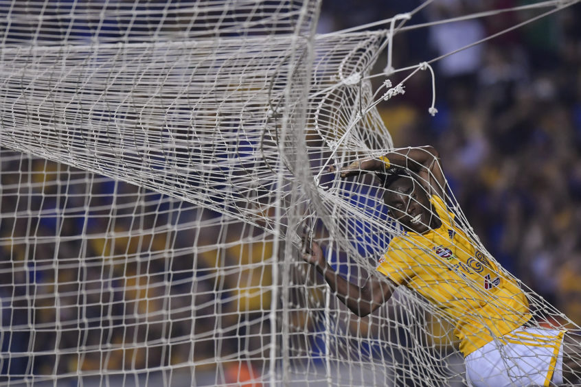 Julián Quiñones of Tigres jumps inside the net during the 9th round match between Tigres UANL and Pachuca as part of the Torneo Clausura 2019 Liga MX at Universitario Stadium on March 02, 2019 in Monterrey, Mexico.
