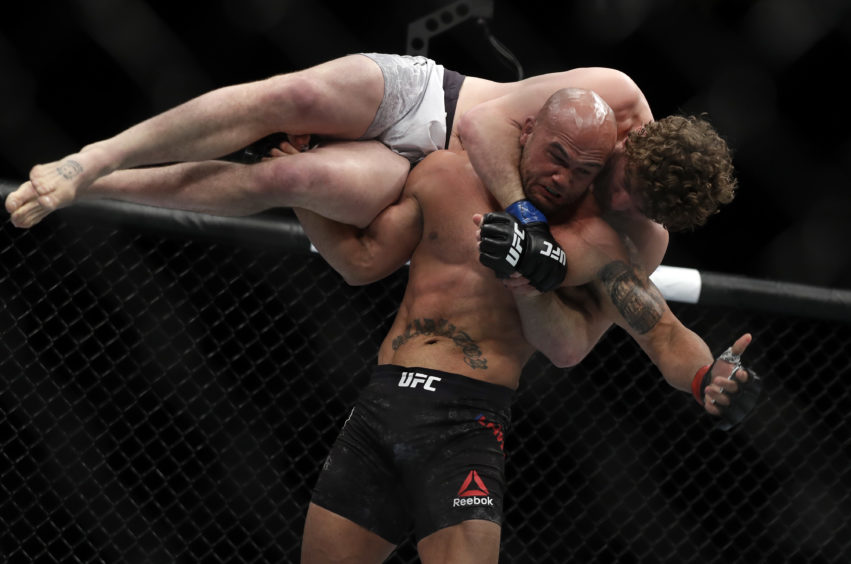 Robbie Lawler lifts Ben Askren before slamming him to the mat during their welterweight bout during UFC 235 at T-Mobile Arena in Las Vegas,