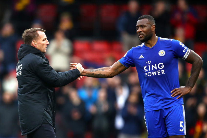 Brendan Rodgers, Manager of Leicester City and Wes Morgan of Leicester City speak after the match during the Premier League match between Watford FC and Leicester City .