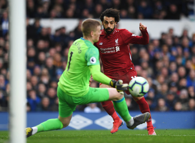 Mohamed Salah of Liverpool is foiled by Jordan Pickford of Everton as he saves during the Premier League match between Everton FC and Liverpool FC at Goodison Park on March 03, 2019 in Liverpool, .