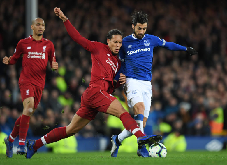 Andre Gomes of Everton and Virgil van Dijk of Liverpool battle for the ball during the Premier League match between Everton FC and Liverpool FC at Goodison Park  in Liverpool.