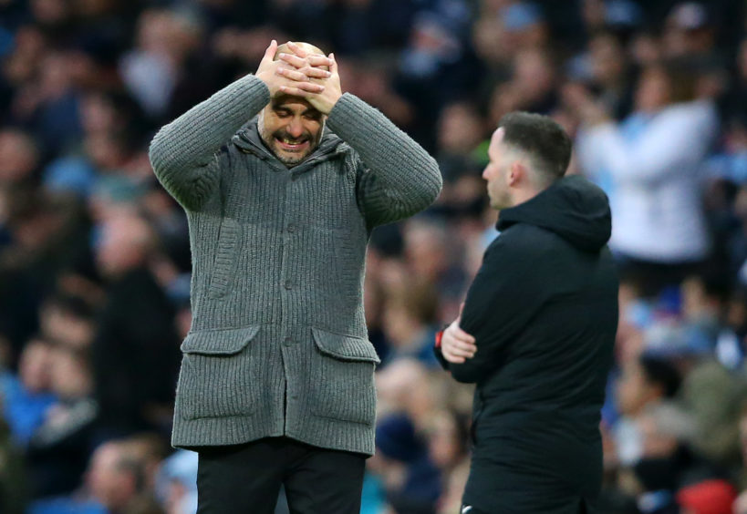 Josep Guardiola, Manager of Manchester City reactsduring the Premier League match between Manchester City and Watford FC at Etihad Stadium in Manchester.