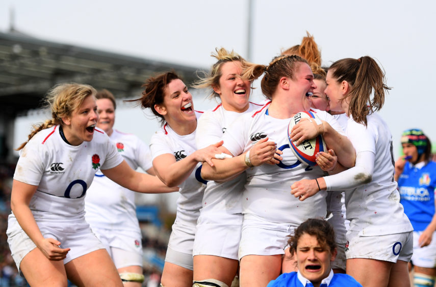 Sarah Bern of England celebrates after scoring her sides fourth try with her England team mates during the Womens Six Nations match between England and Italy at Sandy Park on March 09, 2019 in Exeter, England.