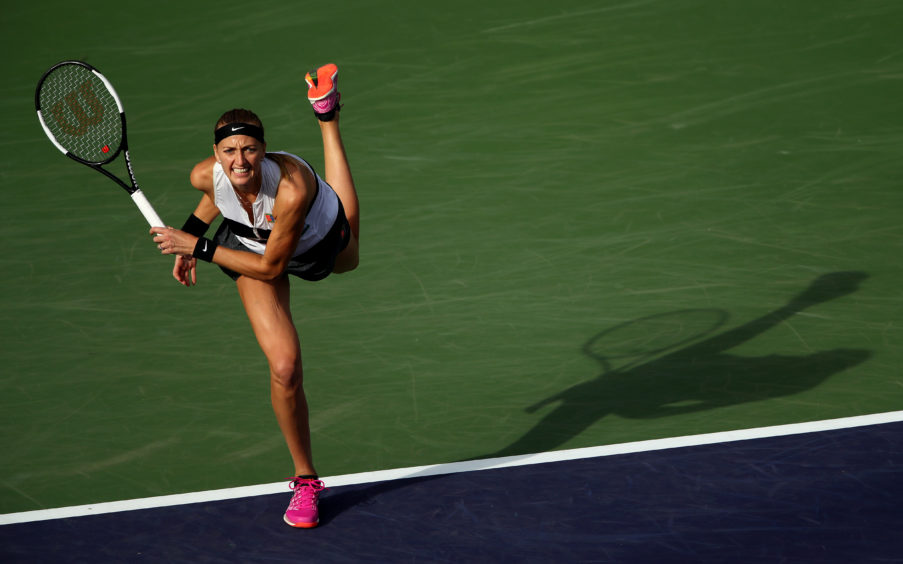 Petra Kvitova of the Czech Republic serves against Venus Williams of the United States during their women's singles second round match on day six of the BNP Paribas Open at the Indian Wells Tennis Garden  in Indian Wells, California.