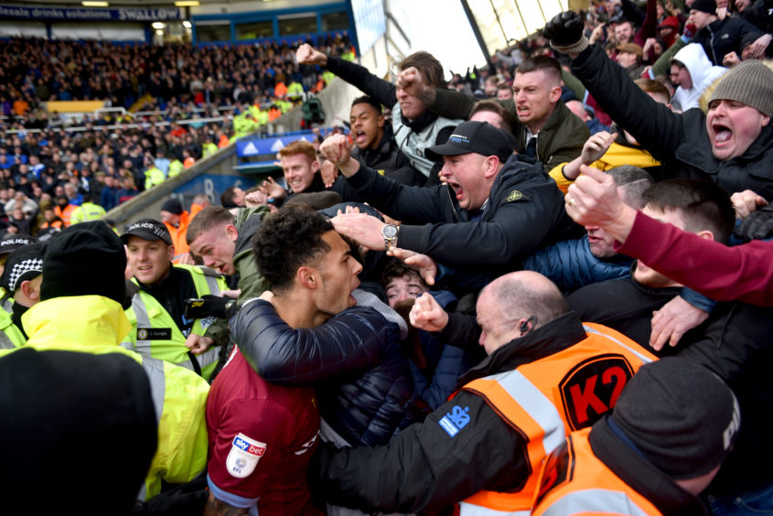 Aston Villa players celebrate with their fans after Jack Grealish of Aston Villa scores his teams first goal during the Sky Bet Championship match between Birmingham City v Aston Villa .