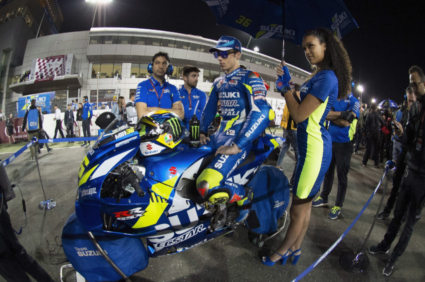 Joan Mir of Spain and Team Suzuki ECSTAR prepares tos tart on the grid during the MotoGP race during the MotoGP of Qatar - Race at Losail Circuit on March 10, 2019 in Doha, Qatar.