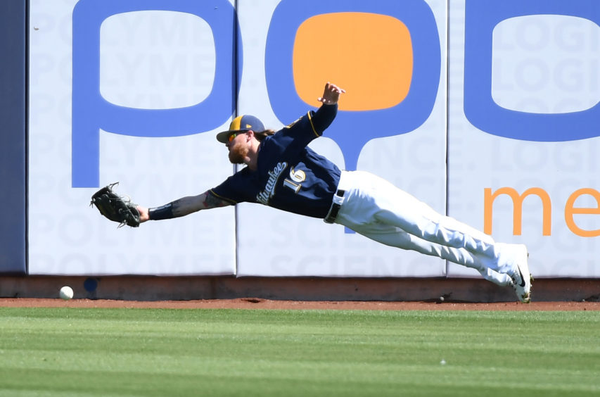 Ben Gamel of the Milwaukee Brewers cannot make a diving catch against the Chicago Cubs during the third inning a spring training game at Maryvale Baseball Park.