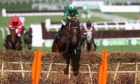 Espoir D'Allen ridden by Mark Walsh clears the final fence during the Unibet Champion Hurdle Challenge Trophy. Michael Steele/Getty Images
