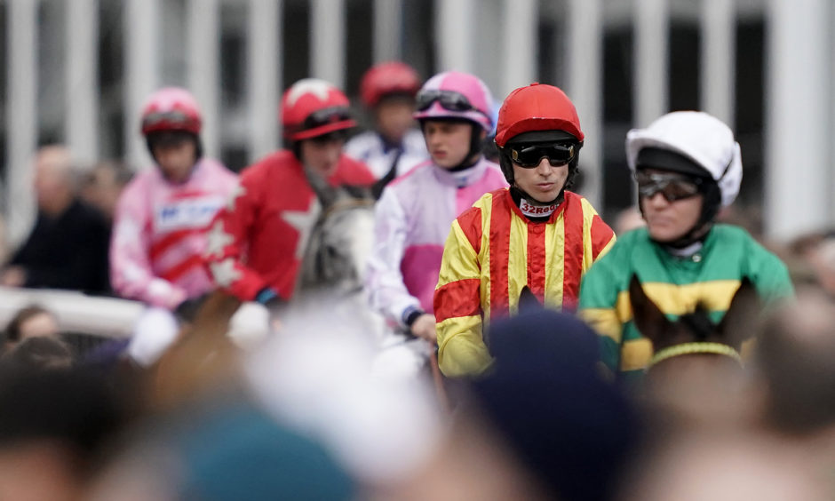 Runners and riders make their way to the course. Alan Crowhurst/Getty Images