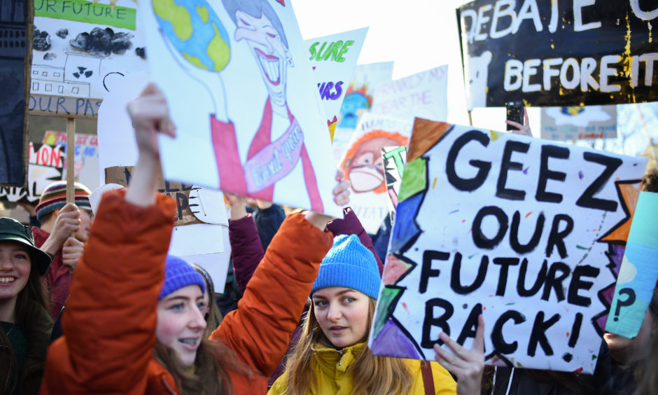 School children hold placards and shout slogans as they participate in a protest outside the Scottish Parliament. Students around the world took to the streets on March 15 to protest a lack of climate awareness and demand that elected officials take action on climate change. Inspired by Greta Thunberg, the 16-year-old environmental activist who started skipping school since August 2018 to protest outside Sweden's parliament, school and university students worldwide have followed her lead and shared her alarm and anger.