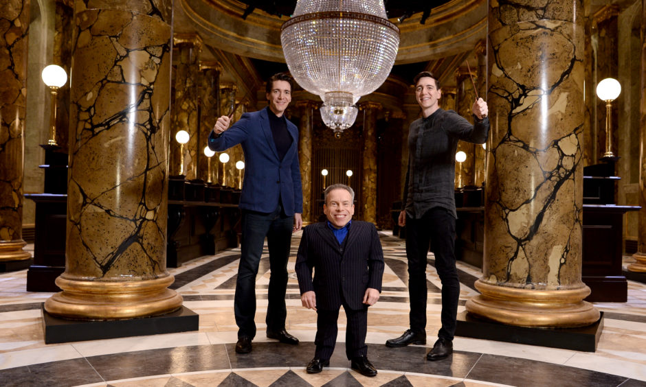Oliver Phelps, Warwick Davis and James Phelps in the original Gringotts Wizarding Bank set at Warner Bros. Studio Tour London on March 19, 2019 in Watford, England. Warner Bros.