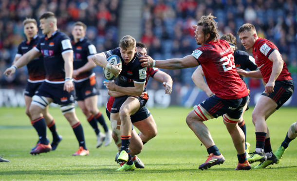 Darcy Graham tries to breach the Munster defence at Murrayfield.