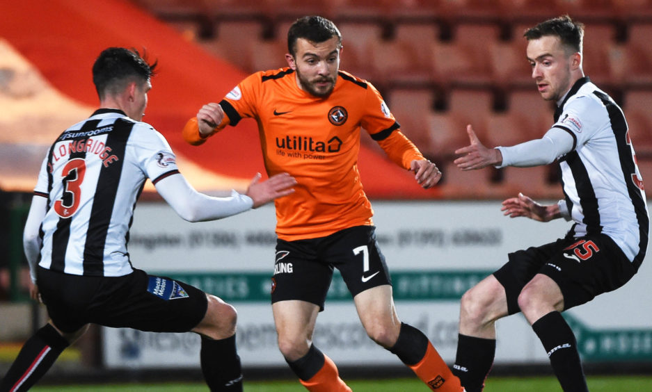 Dundee United's Paul McMullan (centre) in action with Dunfermline's Jackson Longridge (L) and Ryan Blair
