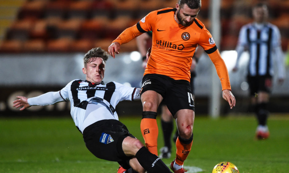 Dundee United's Pavol Safranko (R) is tackled by Dundee United's Lee Ashcroft