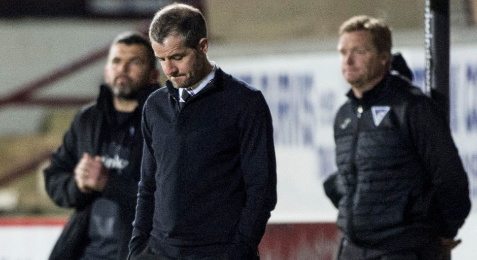 Dunfermline manager Stevie Crawford looks dejected on the touchline