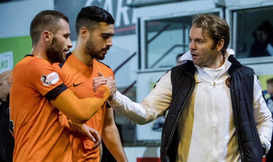 Pavol Safranko (L) with manager Robbie Neilson at full-time