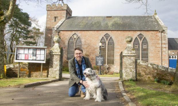 Edzell Parish Church's  Rev Wayne Pearcer with his dog Ben.